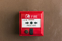 Fire alarm switch. On the wall stock photos