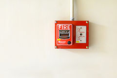 Fire alarm switch on the wall Stock Photos