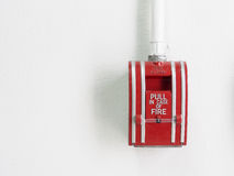 Fire alarm switch on the white wall. Fire alarm switch on white wall royalty free stock image