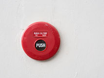 Fire alarm switch on the white wall. In bulidind stock image