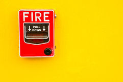 Fire alarm switch on yellow wall Stock Image