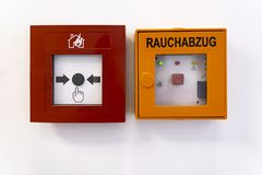 Fire alarm system on the wall. In a office building. Rauchabzug in german language means Smoke Flue royalty free stock photography