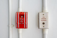 Fire alarm and telephone. Royalty Free Stock Photo