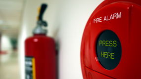 Fire Alarm dan Extinguisher. Ready to take care fire by pressing the fire alarm and extinguisher on the wall stock image