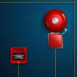 Fire alarm on the wall. Bell, button and wires. Royalty Free Stock Photo