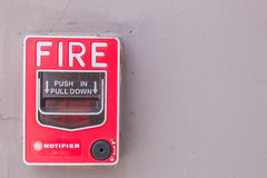 Fire alarm at the wall on building. Royalty Free Stock Photography