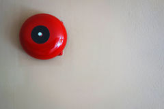 Fire alarm on the wall of Department store building. Red round call point for fire alarm. Red wall mounted Fire Alarm Bell in the Department store building royalty free stock images