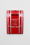 Fire alarm. On the white wall Stock Photography