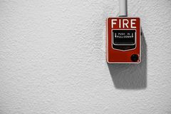 Fire alarm on white wall stock photography