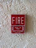 Fire alarm on white wall royalty free stock photos