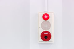 Fire alarm on white wall Royalty Free Stock Photo