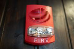 Fire alarm on wooden surface royalty free stock photography