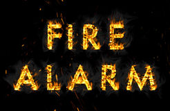 Fire alarm. The word in flames on black background Stock Image