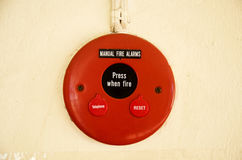 Fire alarms system on wall. Mounted red fire alarm button used to activate warning systems in buildings stock images