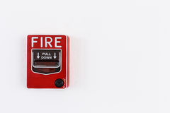 Fire alram pull switch on the white wall Royalty Free Stock Photo