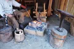 Fire and anvil. Small smithy with fire and anvil Stock Photos
