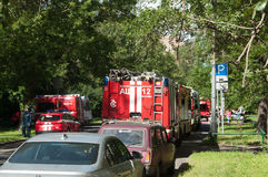 Fire in apartment building, fire engines Stock Images