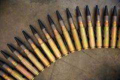 Fire arm ammunition. Firearm ammunition lined arc on the floor Stock Image