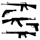 Fire-arms. Silhouettes of pistols and submachine gun on a white background Stock Photography