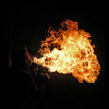 Fire artist performing fire breathing Royalty Free Stock Photography