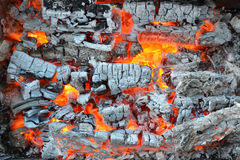 The fire and ashes background. The fire and ashes in the metal brazier background Royalty Free Stock Photo