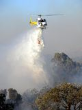 Fire Attack. Helicpter dropping water on a bushfire. North Beach, Perth, Western Australia royalty free stock images