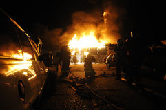 Fire in auto repair shop stock image