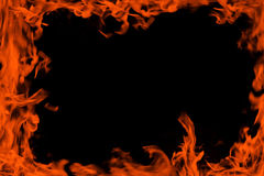 Fire background frame. Decorative frame / border backdrop with fire / flame / blaze pattern / texture isolated on black background with empty copy space. Can be Stock Images