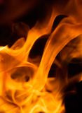 Fire background. Flames over black - perfect fire background Stock Photos