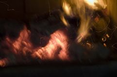 Fire background 3. Fire from a real fireplace, - see the change on the evil face at right - useful background series 3 of 4 stock photo