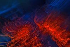 Fire background abstraction. Fiery wings. abstract flame of a fire. grid elements. red and dark blue color Royalty Free Stock Photo