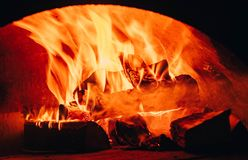 Fire background. Beautiful Fire Close-Up. Video. Burning Firewood in the Fireplace. Firewood Burn in the wood burning. Stove Royalty Free Stock Photo