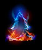 Fire background, Christmas tree symbol. Fire background Christmas tree  symbol made od flames Royalty Free Stock Photo
