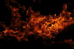 Fire background in the night. (on the black background Royalty Free Stock Image
