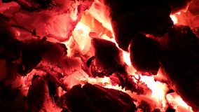 Fire background - red hot glowing charcoals inside stove stock video footage