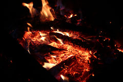 Fire background. Shot of the fire with smouldering coal pieces Stock Image