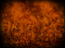 Fire background. With small skulls hiding in the flames. Great for music and heavy metal styles Stock Photos