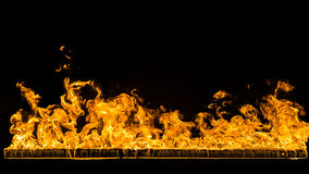 Fire background. Widescreen background , hot fire on black Stock Photography