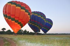 Fire balloons going up rise stock photography