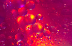 Fire Balls. A depiction of balls or bubbles on fire using oil on water macro. Looks like bubbles suspended in liquid floating around on fire. Good abstract for Royalty Free Stock Image