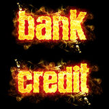 Fire Text Bank Credit. Bank credit words in blazing flames Stock Image