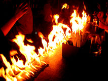 Fire in the bar. A bartender impresses the pub customers with their table on fire trick Stock Photos
