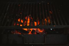 Fire of a barbecue with burning ashes on the air royalty free stock photo