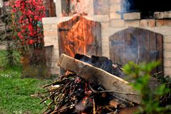 Fire for the barbecue in the home garden in a spring day royalty free stock photography