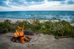Fire on the beach on the black sea stock image