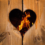 Fire behind a heart Stock Image