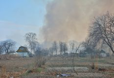 Fire behind summerhouses 2. A brushfire behind summerhouses. Russian Far-East stock photography