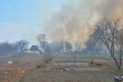 Fire behind summerhouses 1. A brushfire behind summerhouses. Russian Far-East stock photos