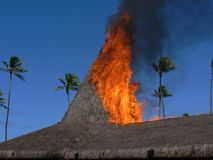 Fire behind tropical house Royalty Free Stock Images