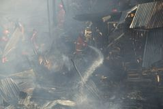 FIRE OF BIBIS MARKET. Local firemen fights fire that raze Bibis Furniture Market, in Solo, Java, Indonesia Stock Photo